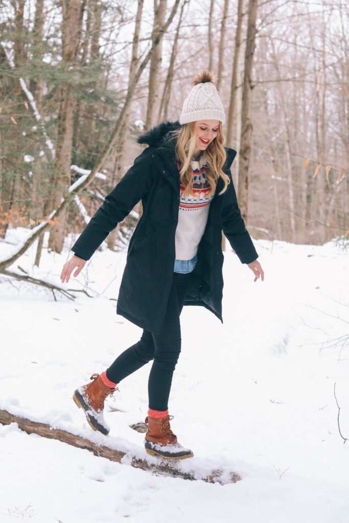 Lifestyle blogger Leigha Gardner of The Lilac Press frolicking in the snow after a storm in the Berkshires