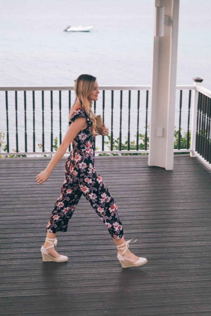 Style blogger Leigha Gardner of The Lilac Press wearing a floral Club Monaco jumpsuit while heading to dinner on Saint Thomas, USVI