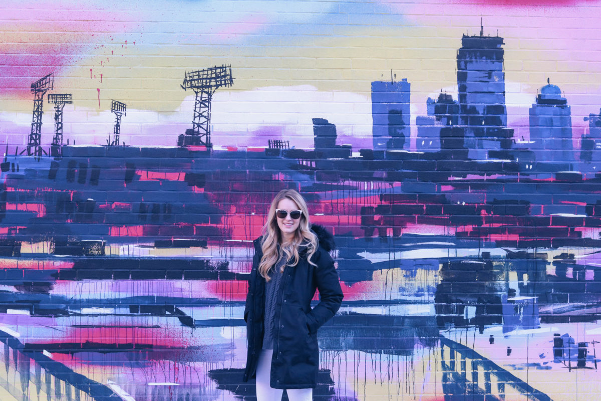 Lifestyle blogger Leigha Gardner of The Lilac Press exploring unexpected color pops in Boston (wall crawl).