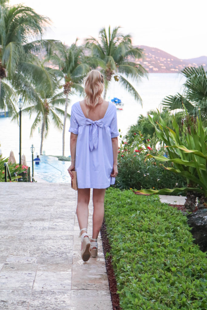 Style blogger, Leigha Gardner, of The Lilac Press twirling around St. Thomas in a little blue dress; showing off shirting material trends for spring.