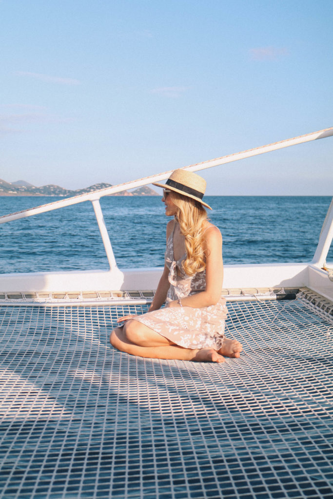 Lifestyle blogger, Leigha Gardner, of The Lilac Press sharing evening sailing style while heading to St. John, USVI, for dinner.