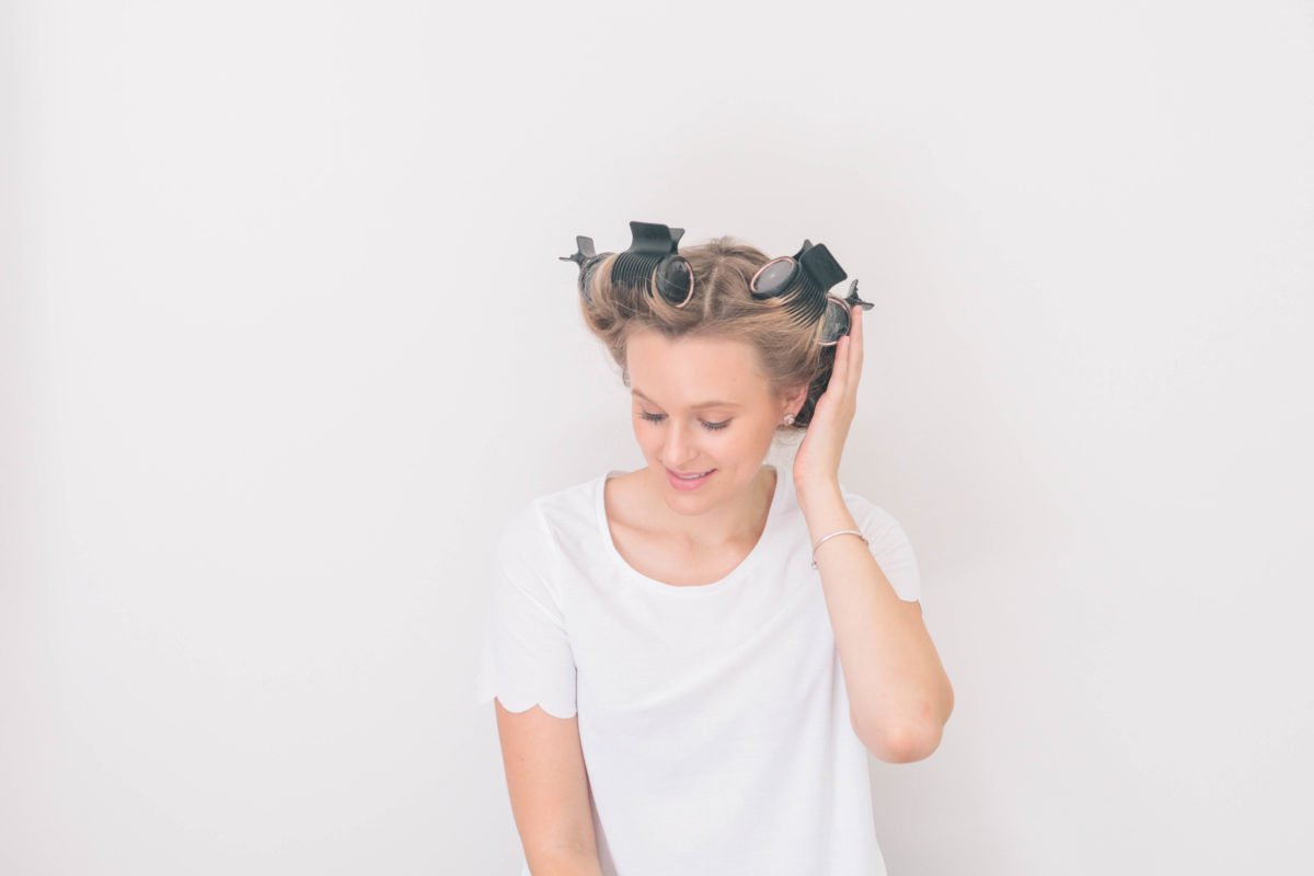 Style and beauty blogger, Leigha Gardner, of The Lilac Press using hot rollers for added hair volume and bounce.