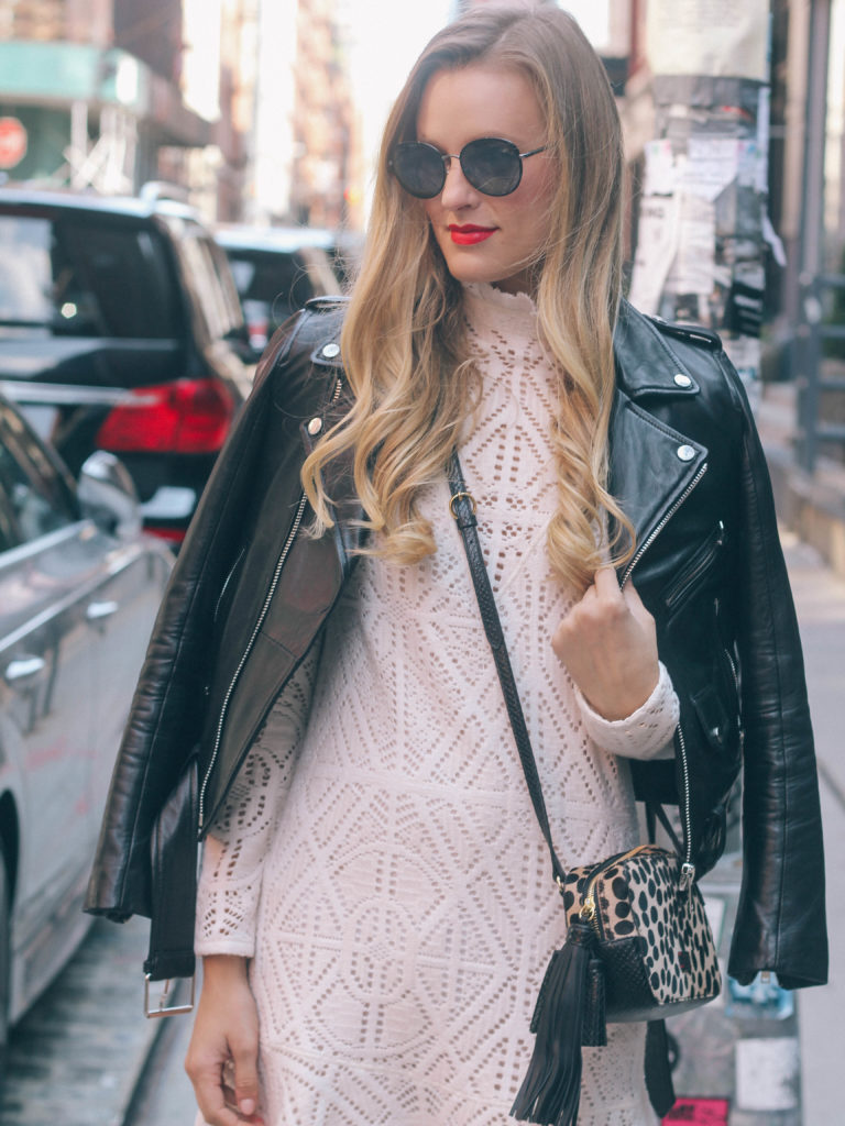 Style blogger, Leigha Gardner, of The Lilac Press wearing a white See by Chloe lace dress coupled with a leather jacket in the cobblestone streets of Soho.