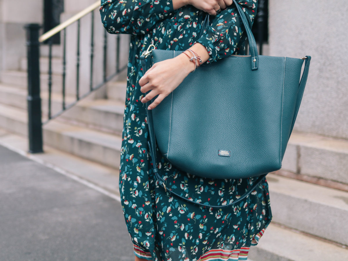 Fashion blogger, Leigha Gardner, of The Lilac Press wearing a transitional summer-to-fall outfit featuring of a teal floral Suncoo dress in New York City