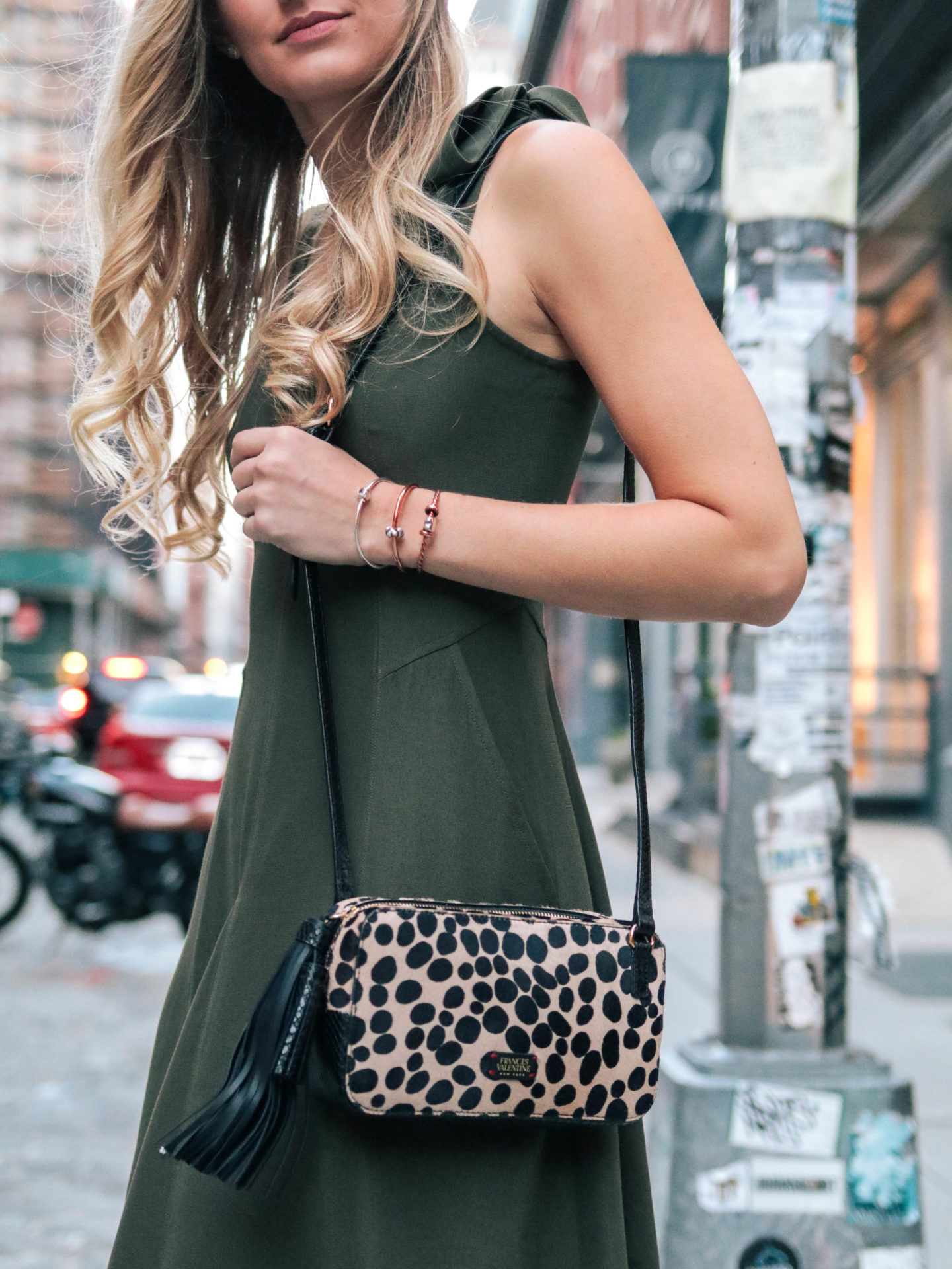 Fashion blogger, Leigha Gardner, of The Lilac Press showcasing a olive Ulla Johnson dress, and a leopard print Frances Valentine calf hair crossbody